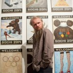 """Василий Слонов на фоне своих работ из серии """"Welcome to Sochi 2014"""""""